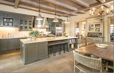 Notice the washed cabinet holding dishes. Goes well with McGuire chairs and rustic table... and the olive cabinets with limestone counters.