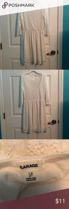 Scoop back white lace Garage dress Adorable dress!! It's a lot cuter and more flowy when it's on a person. It's comfortable and the lace is surprisingly soft. Never worn, only tried on, selling because it's not really my style. Willing to take offers. Garage Dresses Midi