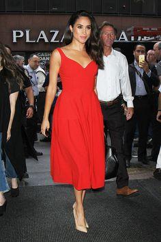 Meghan Markle radiant in a red dress in July 2016 (REX/Shutterstock)