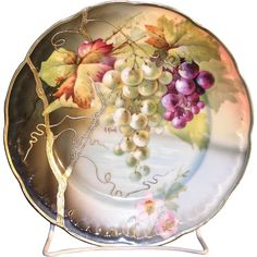 Beautiful J & C Senta Hand painted porcelain plate with hanging Grape and Floral design. This excellent plate Is skillfully decorated and artistically