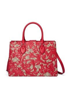 Gucci. Canvas with leather overlay detail.