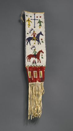 Sioux Beaded and Fringed Hide Pictorial Bag  -- This is most likely a man's pipe bag, though Sotheby's Auction has it labeled as a tobacco bag, which is not likely to be correct. In part, pipe bags can be identified by their long, narrow shape -- tobacco bags are much smaller.  (Item from a Sotheby's auction, date unknown).