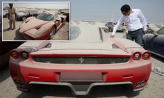 Ferrari Enzo seen covered in dust abandoned in Dubai. The red motor - owned by a Brit - is one of the top 10 fastest ever road cars ever produced. It is thought the owner was being chased for unpaid traffic fines after abandoning the supercar 20 months ago.