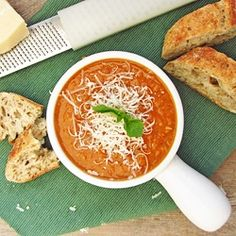 Roasted Tomato Soup - A warm, hearty, and healthy winter soup with roasted tomatoes & garlic, and pureed white beans as a thickener!