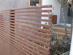 corten slats: great way to shield the neighbors. I'd like to do this on my porch