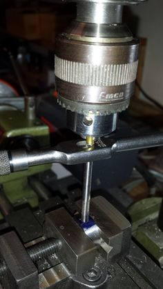 Manually taping an 8-32 thread. Place a short brass tube in the drill press chuck as simple way to align the tap with its pointed end at the top of the tap.
