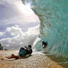 Clark Little Photography ~ Clark shooting seabass perez in the shore break  a couple days ago. Photo by Tharin Rosa 4fa52c37f3fd