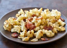 Roasted Cauliflower Recipe with Bacon and Garlic Recipe. So easy and so delicious. The bacon adds the savory to the cauliflower and roasting gives the cauliflower such a great texture! Garlic Recipes, Bacon Recipes, Paleo Recipes, Cooking Recipes, Delicious Recipes, Easy Recipes, Roasted Cauliflower, Cauliflower Recipes, Cauliflower Salad