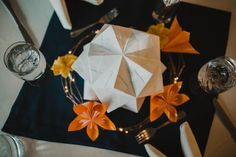 Glowing vellum centerpieces with paper flowers