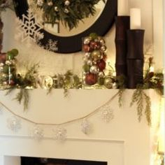 """Christmas; Holiday fireplace mantle decorations.  I think this is a great way to decorate a home or office as the seasons or occasions change.  Simply keep the candle bases and the glass vases and then switch out the candles to a new color and pick a new """"themed"""" filler for the tall vases - and you've re-decorated on a dime budget. I love this idea!"""