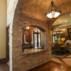 Mediterranean Kitchen by Terry M. Elston, Builder.  Love this massive brick archway inside of the house.