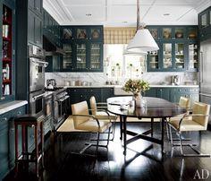 Beautiful gray-green cabinets with dark floors