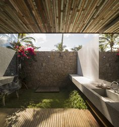 Txai House - Studio MK27 _ bathrooms opened to the outside with their own garden; local materials; local colors and influences; cross ventilation; different concept: person has to  feel the nature to go from the private areas to the living areas; casa foda.