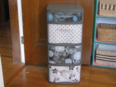 Decorate those cheap plastic drawers with scrapbook paper.