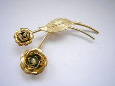 Vintage gold tone metal flower pattern filigree by badgestuff, $5.00