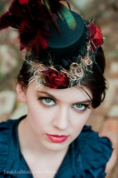 Little Black top hat with Garnet Feathers and Roses -- I adore!  From LaCocoRouge on Etsy.com  http://www.etsy.com/listing/59929023/black-mini-top-hat-with-red-roses-and?ref=tre-1706518846-4