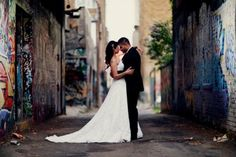 love the contrast between the graffiti walls and the simplicity of the bride and groom. <3