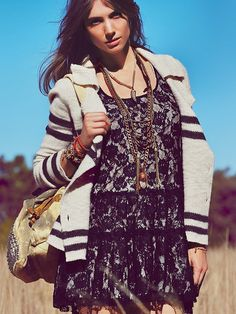 knits over delicate dresses