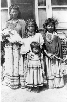 Seminole mother with her children including five day old baby. 1948