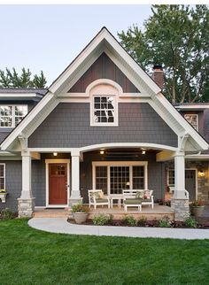 exterior paint colour plus stone is same as current dark grey siding Exterior Traditional with arch window front porch
