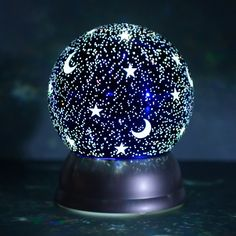 moon Gaze into a starry sky any time you wish with our Moon and Stars Light-Up Water Globe, a Cracker Barrel Exclusive! This unique tabletop accent features glittery stars and moons that add an Night Light, Light Up, Galaxy Bedroom, Old Country Stores, Water Globes, Cute Room Decor, Crystal Ball, Stars And Moon, Christmas Lights