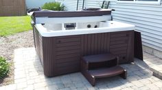 Here is a Master Spas Legacy Spa installed on a brick patio.