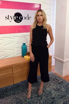 Erin Foster Tank Top - Erin Foster was nautical-chic in a black Tamara Mellon tank top adorned with gold buttons down the sides while visiting Amazon's 'Style Code Live.'