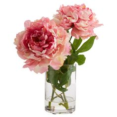 Create a lush tablescape or charming vignette with this lovely faux peony arrangement, nestled in a classic glass vase with artificial water.
