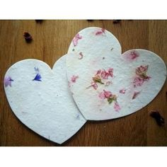 Seeded plantable hearts on petal paper...such a cute favor! You plant them and they grow wild flowers!