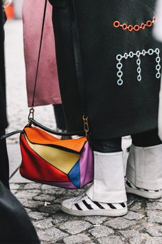 Street Style outfit with Lowe puzzle bag and striped sneakers. See more at www.HerStyledView.com