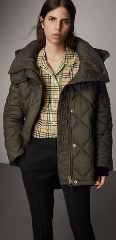 A diamond-quilted jacket by Burberry cut for an enveloping oversized fit. The protective design features an exaggerated, detachable hood and deep patch pockets. Layer over knitwear on cooler days.