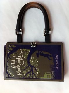 TEACHER GIFT? PLEASE, SOMEBODY? To Kill A Mockingbird Book Purse - Field of Purple Flowers Lining. $45.00, via Etsy.