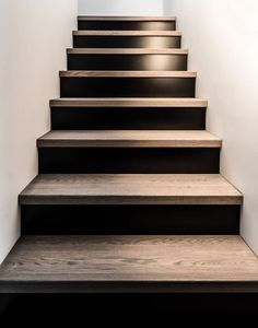 House on Stilts by Dizaino Virtuve - Your source of Architecture and Interior design news! Staircase Design, Stair Design, Wood Staircase, Railing Design, Staircase Remodel, Staircase Ideas, Black Stairs, Black Painted Stairs, Stair Makeover