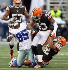 Dallas' Kevin Ogletree (85) is rocked by a vicious hit by Cleveland's T.J.Ward (43), and was injured, in the fourth quarter during the Cleveland Browns vs. the Dallas Cowboys NFL football game at Cowboys Stadium in Arlington on Sunday, November 18, 2012.  Photo: Louis DeLuca/Staff Photographer