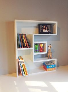 These letter bookshelves are the perfect way to personalize your childs room. Handmade out of beautiful pine wood. This shelf ships fully assembled.  Approximate Dimensions: 29H x 23 7/8W x 5 1/2D Width may change slightly depending on the letter.  Note: Because of its 5.5 depth these bookshelves are better for youth chapter books, small baby books, and displaying knick-knacks. Larger books may hang out further than shelf. If youre looking for a deeper bookcase please visit my A-Z Letter…