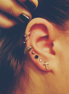 I like when people have piercings all up their ear, but only when they don't all match.