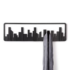 New York, London, Hong Kong: great cities have great skylines. Celebrate the glory of skylines with this set of hooks with a contemporary twist. Five skyscrapers flip forward so you can hang an array of items.
