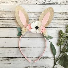 ****Current turnaround time is 1-3 weeks**** Cute and playful brown woodland bunny ears headband. The headband is wrapped in ribbon and fits 18 months to adult. Felt ears decorated with felt flowers/leaves and fabric roses. Colors may vary very slightly due to availability