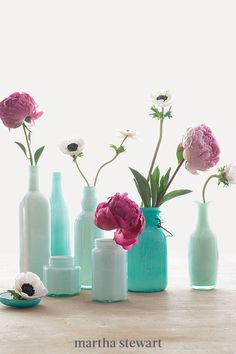Transform everyday vessels into elegant vases by coating their interiors with glass enamel. Any container will do—buy up old bottles at a flea market, or try kitchen cast-offs, such as jam jars. We used white enamel, which yielded different shades of green depending on the tint of the glass. #marthastewart #diydecor #diyprojects #diyideas #hobby Recycled Bottles, Bottles And Jars, Glass Bottles, Mason Jars, Painted Bottles, Painted Vases, Empty Bottles, Reuse Bottles, Bottle Vase