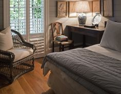 Guest bedroom with painted shiplap walls & comfortable, practical furnishings - Marco Meneguzzi