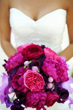 Elegant-malibu-wedding-with-bold-wedding-flowers-pink-purple-bridal-bouquet.original. love the dress.