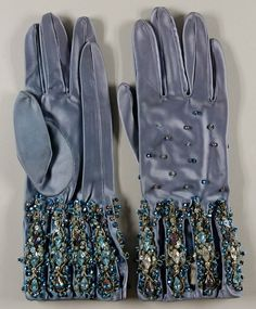 Woman's gloves by Elsa Schiaparelli, Paris, circa 1938. Materials: blue rayon satin with jewels, brilliants, sequins, and couched metallic cord | Philadelphia Museum of Art