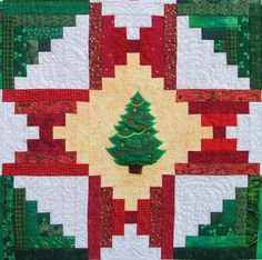 Christmas Quilt, log cabin with appliqued tree.  Pattern and tutorial at Advanced Embroidery Designs.