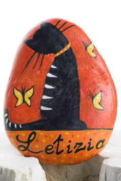 Hand-painted stones with flowers or cats and your name..Great cat!