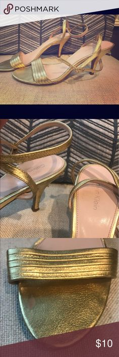 """Calvin Klein Gold Ankle Heels SZ 7.5 Attention!! Extremely LOVED Calvin Klein gold heels. These babies did a lot of dancing but ready to be passed to another owner. Could possibly be repaired. The heels show signs of wear but uppers are in good condition. Strappt ankle relook with delicate gold over the toe strap. 2.5"""" heel. Calvin Klein Shoes Heels"""
