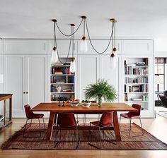 dining   library   shelves   wooden floors   rug   bold lighting   open plan