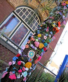 Yarn bombing with flowers.  You SEW Girl: Multi-faceted weekend