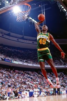 Shawn Kemp of the Seattle Supersonics attempts a dunk during the 1990 Slam Dunk Contest as part of AllStar Weekend on February 10 1990 at Miami Arena. Kentucky Basketball, Basketball Shirts, Basketball Legends, Duke Basketball, Sports Basketball, College Basketball, Basketball Players, Kentucky Wildcats, Nba Pictures