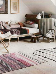I like the Native / South American and North African patterns and textures that are currently trending - and in such beautiful colours. Little ethnic boho bedroom.