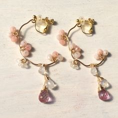 These screw back earrings are custom made. Replaced rose quartz drop with pink topaz drop.